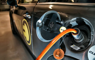 electric car charger plugged into car