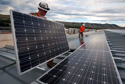 workers and solar panels