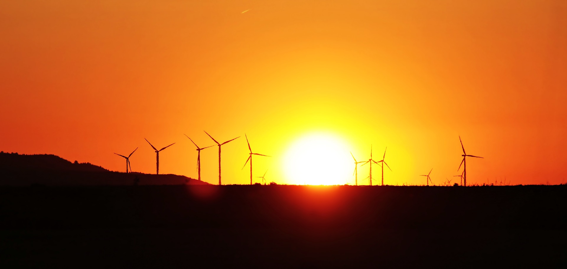 sunset with windmills in foreground