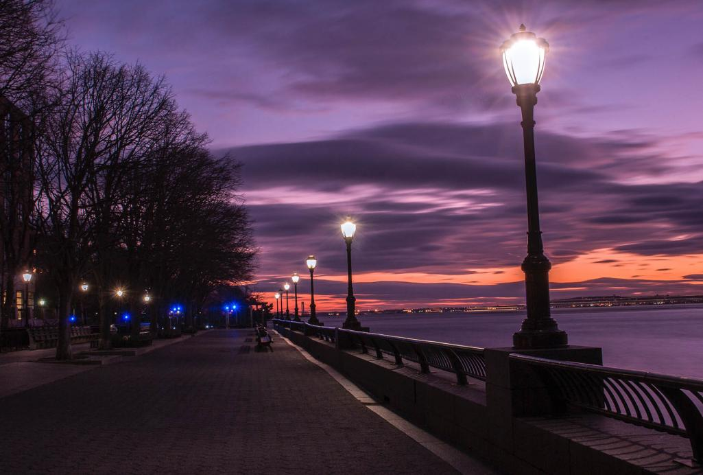 photography-of-turned-on-street-lamps-beside-bay-during-771883